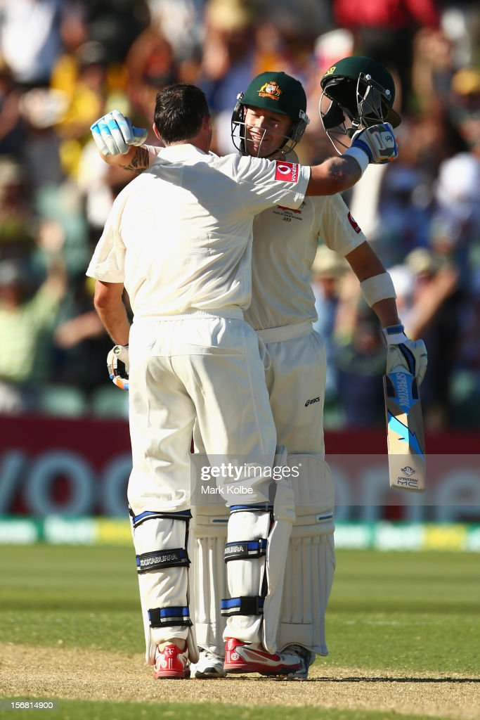 <a gi-track='captionPersonalityLinkClicked' href=/galleries/search?phrase=Michael+Hussey&family=editorial&specificpeople=171690 ng-click='$event.stopPropagation()'>Michael Hussey</a> of Australia embraces Michael Clarke of Australia as he celebrates his century during day one of the 2nd Test match between Australia and South Africa at Adelaide Oval on November 22, 2012 in Adelaide, Australia.