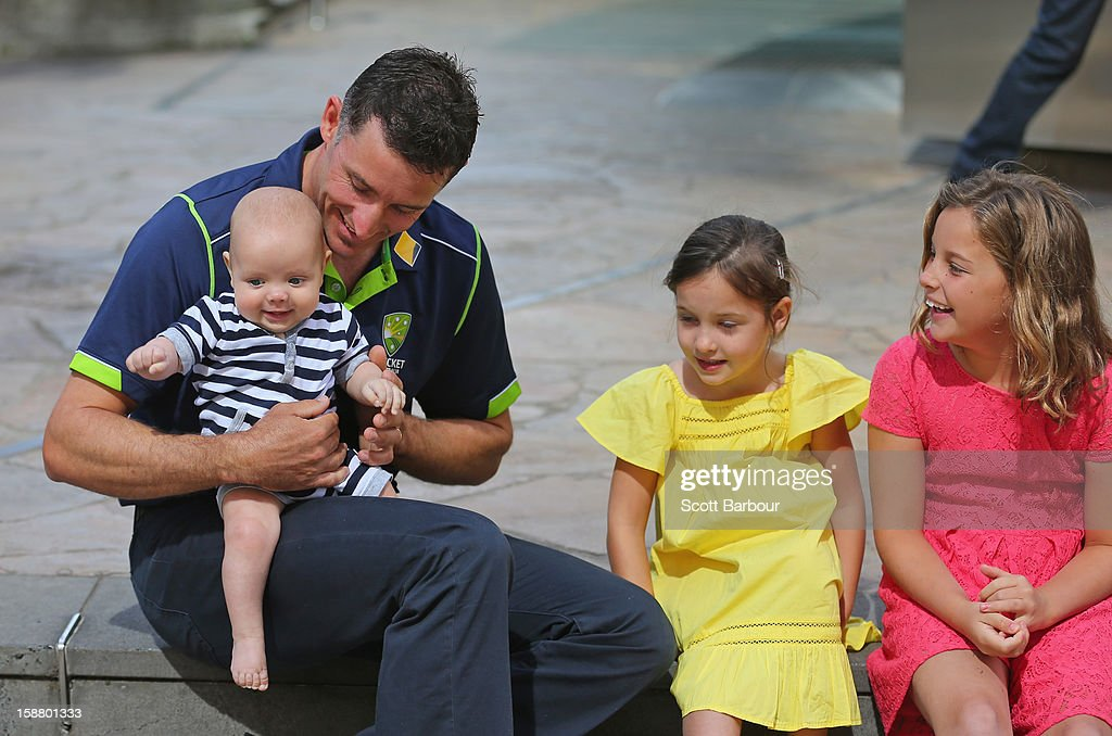 <a gi-track='captionPersonalityLinkClicked' href=/galleries/search?phrase=Michael+Hussey&family=editorial&specificpeople=171690 ng-click='$event.stopPropagation()'>Michael Hussey</a> of Australia holds his son Oscar as he talks to his daughters Jasmin and Molly after a press conference on December 30, 2012 in Melbourne, Australia. Mike Hussey has announced that the third Vodafone Test against Sri Lanka in Sydney will be his last Test for Australia.