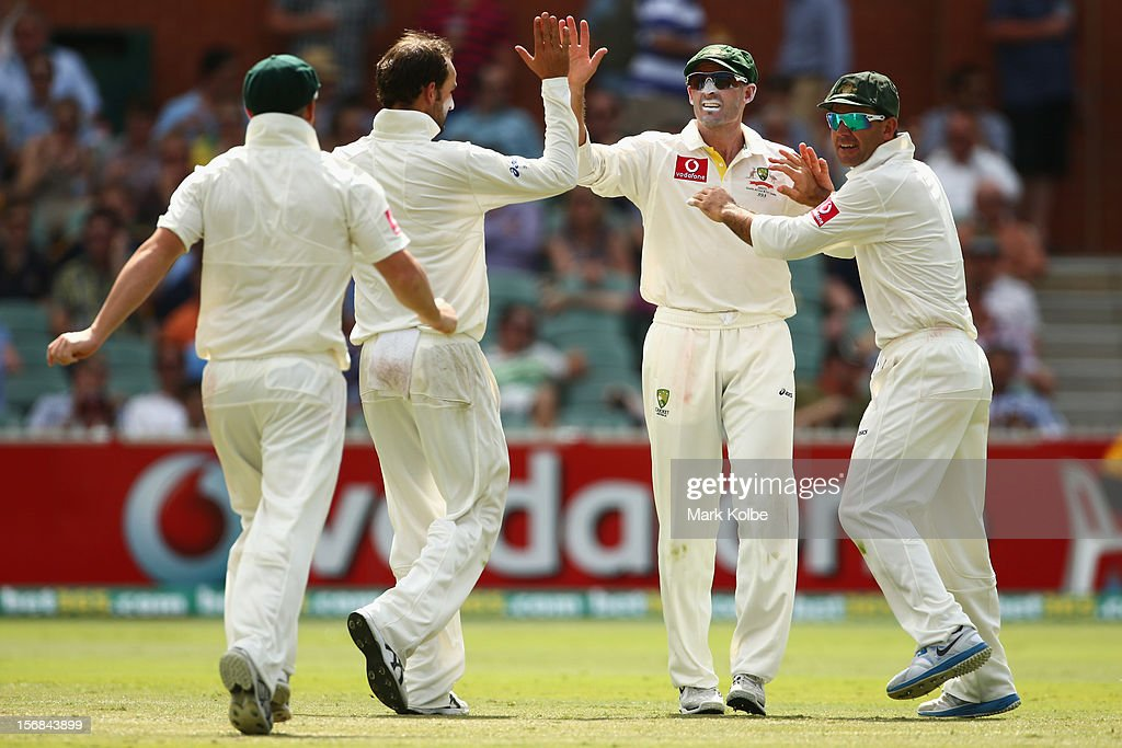 Michael Hussey of Australia is congratuated by his team mates after he ran out Alviro Petersen of South Africa bats during day two of the Second Test match between Australia and South Africa at Adelaide Oval on November 23, 2012 in Adelaide, Australia.