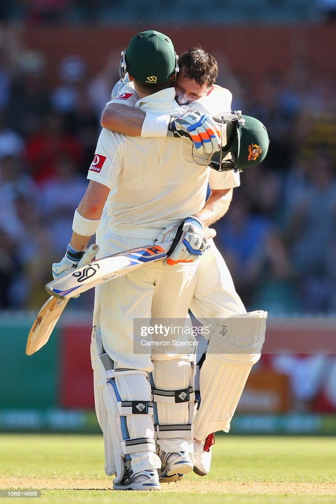 Michael Hussey of Australia is congratulated by captain Michael Clarke after scoring a century during day one of the 2nd Test match between Australia and South Africa at Adelaide Oval on November 22, 2012 in Adelaide, Australia.