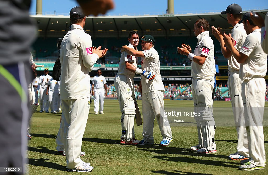 Michael Hussey of Australia is congratulated by David Warner of Australia after his last last test match during day four of the Third Test match between Australia and Sri Lanka at Sydney Cricket Ground on January 6, 2013 in Sydney, Australia.