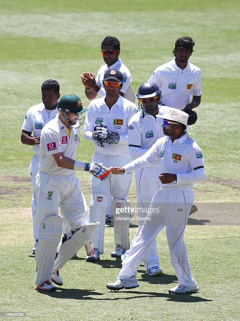 Michael Hussey of Australia is congratulated by Mahela Jayawardene, captain of Sri Lanka as he walks out to bat during his last test during day two of the Third Test match between Australia and Sri Lanka at Sydney Cricket Ground on January 4, 2013 in Sydney, Australia.