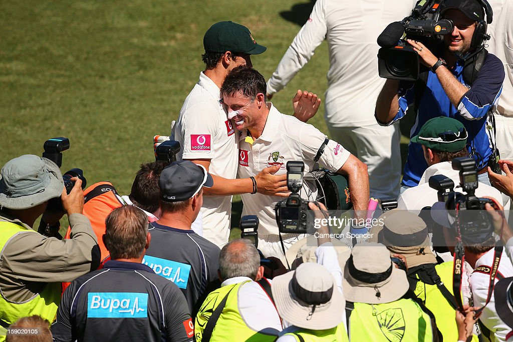 Michael Hussey of Australia is embraced by team mate Mitchell Starc after winning his last test during day four of the Third Test match between Australia and Sri Lanka at Sydney Cricket Ground on January 6, 2013 in Sydney, Australia.