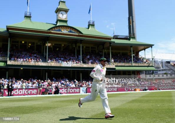 Michael Hussey of Australia leads his team onto the field for his final test during day one of the Third Test match between Australia and Sri Lanka...