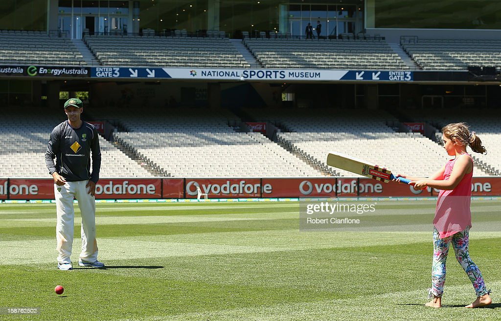 Michael Hussey of Australia plays cricket with his daughter Jasmine after Australia defeated Sri Lanka on day three of the Second Test match between Australia and Sri Lanka at Melbourne Cricket Ground on December 28, 2012 in Melbourne, Australia.