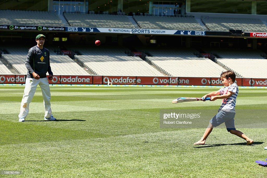 Michael Hussey of Australia plays cricket with his son William after Australia defeated Sri Lanka on day three of the Second Test match between Australia and Sri Lanka at Melbourne Cricket Ground on December 28, 2012 in Melbourne, Australia.