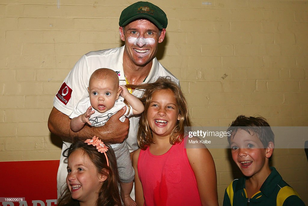 <a gi-track='captionPersonalityLinkClicked' href=/galleries/search?phrase=Michael+Hussey&family=editorial&specificpeople=171690 ng-click='$event.stopPropagation()'>Michael Hussey</a> of Australia poses in the change room with his children Molly, Oscar (being held) Jasmin and William after his retirement from international cricket after day four of the Third Test match between Australia and Sri Lanka at Sydney Cricket Ground on January 6, 2013 in Sydney, Australia.