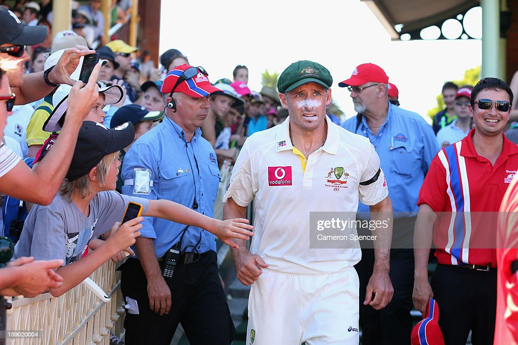 Michael Hussey of Australia runs onto the pitch for the post match presentation after playing his last test during day four of the Third Test match between Australia and Sri Lanka at Sydney Cricket Ground on January 6, 2013 in Sydney, Australia.