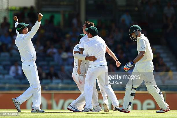 Michael Hussey of Australia walks back to the rooms after being dismissed by Dale Steyn of South Africa during day four of the Third Test Match...