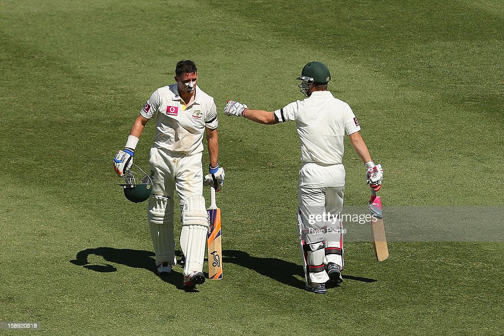 Michael Hussey of Australia walks from past Matthew Wade of Australia after being run out during his last test during day two of the Third Test match between Australia and Sri Lanka at Sydney Cricket Ground on January 4, 2013 in Sydney, Australia.