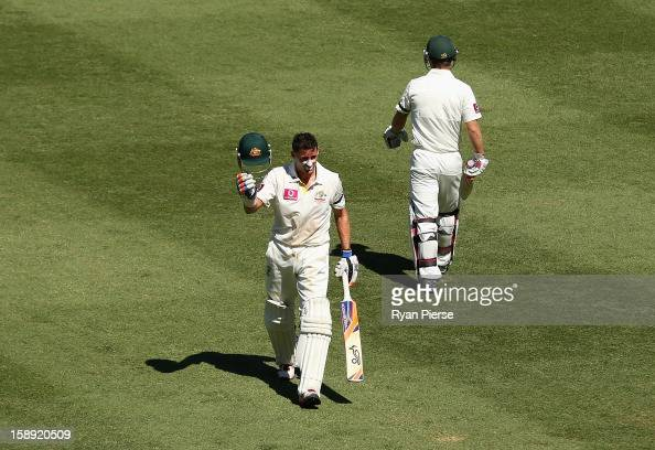 Michael Hussey of Australia walks from the ground after being run out during his last test during day two of the Third Test match between Australia...