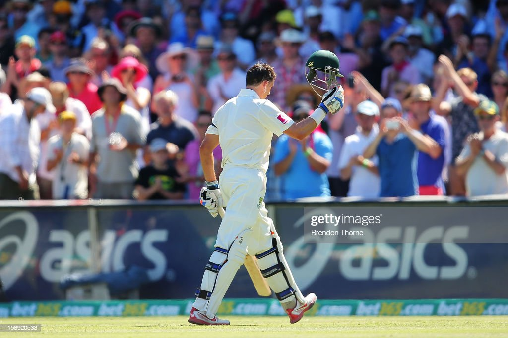 Michael Hussey of Australia walks off the SCG playing field after being run out by Dimuth Karunaaratne of Sri Lanka during day two of the Third Test match between Australia and Sri Lanka at Sydney Cricket Ground on January 4, 2013 in Sydney, Australia.
