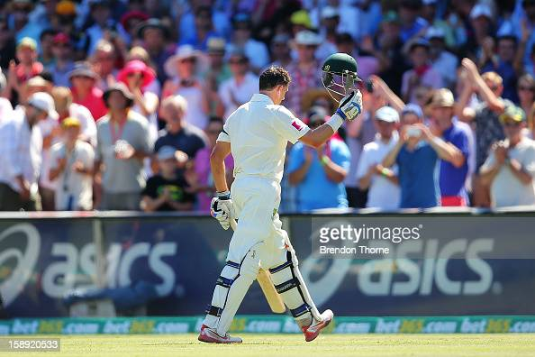Michael Hussey of Australia walks off the SCG playing field after being run out by Dimuth Karunaaratne of Sri Lanka during day two of the Third Test...