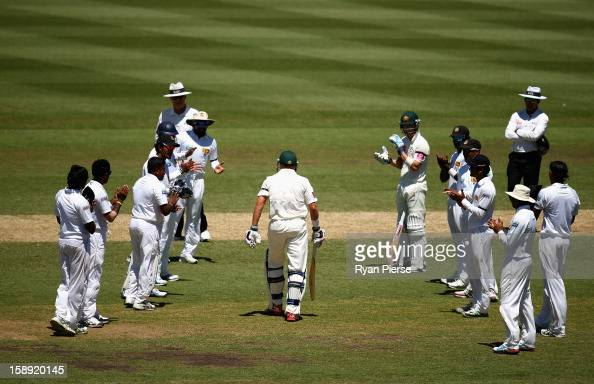 Michael Hussey of Australia walks out to bat through a guard of honour by the Sri Lankan team during his last test during day two of the Third Test...