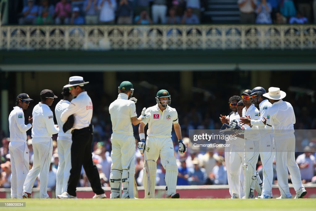 Michael Hussey of Australia walks through a guard of honour onto the pitch in his last test match during day two of the Third Test match between Australia and Sri Lanka at Sydney Cricket Ground on January 4, 2013 in Sydney, Australia.