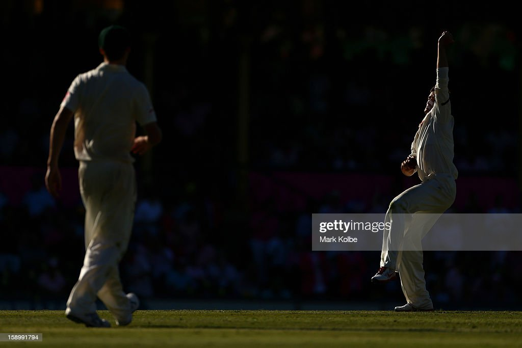 Michael Hussey of Australia warms up to bowl during day three of the Third Test match between Australia and Sri Lanka at Sydney Cricket Ground on January 5, 2013 in Sydney, Australia.