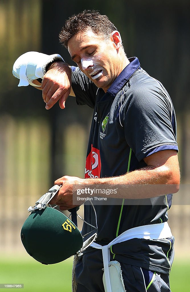 <a gi-track='captionPersonalityLinkClicked' href=/galleries/search?phrase=Michael+Hussey&family=editorial&specificpeople=171690 ng-click='$event.stopPropagation()'>Michael Hussey</a> of Australia wipes the sweat off his forehead following an Australian nets session at Sydney Cricket Ground on January 1, 2013 in Sydney, Australia.