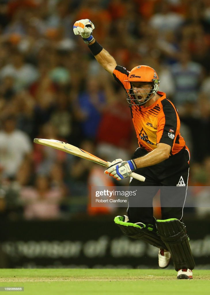 <a gi-track='captionPersonalityLinkClicked' href=/galleries/search?phrase=Michael+Hussey&family=editorial&specificpeople=171690 ng-click='$event.stopPropagation()'>Michael Hussey</a> of the Scorchers celebrates after he scored the winning run during the Big Bash League semi-final match between the Perth Scorchers and the Melbourne Stars at the WACA on January 16, 2013 in Perth, Australia.