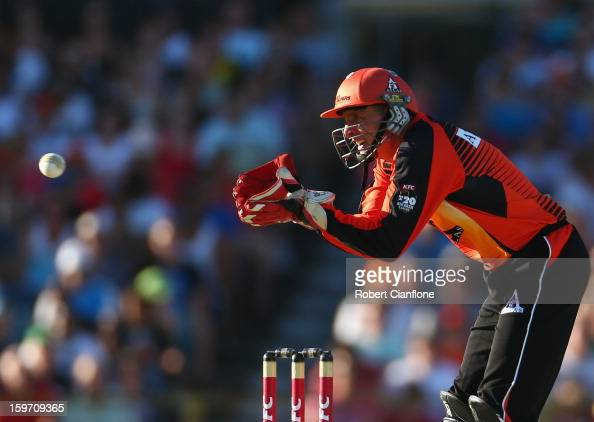 Michael Hussey of the Scorchers wicketkeeps during the Big Bash League final match between the Perth Scorchers and the Brisbane Heat at WACA on...
