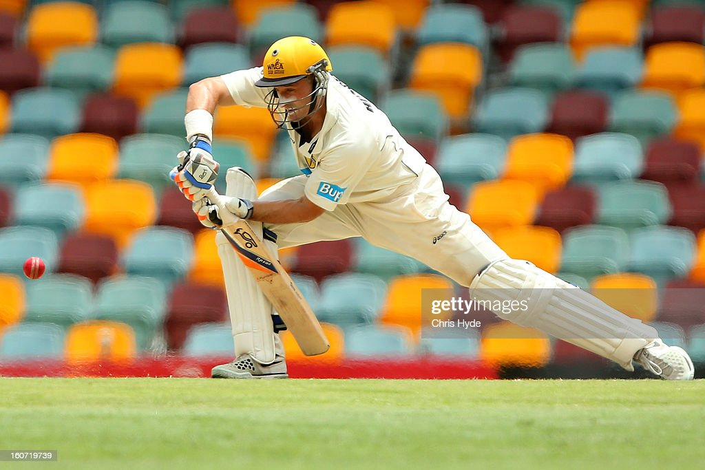 Michael Hussey of the Warriors bats during day two of the Sheffield Shield match between the Queensland Bulls and the Western Australia Warriors at The Gabba on February 5, 2013 in Brisbane, Australia.
