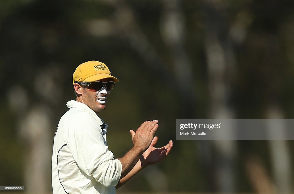 Michael Hussey of the Warriors encourages his teammates during day two of the Sheffield Shield match between the New South Wales Blues and the Western Australia Warriors at Blacktown International Sportspark on January 25, 2013 in Sydney, Australia.