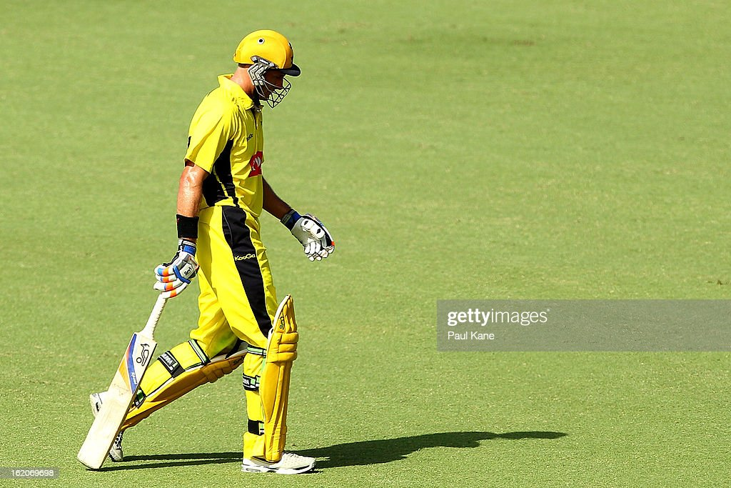 Michael Hussey of the Warriors walks back to the rooms after being dismissed by James Faulkner of the Tigers during the Ryobi One Day Cup match between the Western Australia Warriors and the Tasmanian Tigers at the WACA on February 19, 2013 in Perth, Australia.