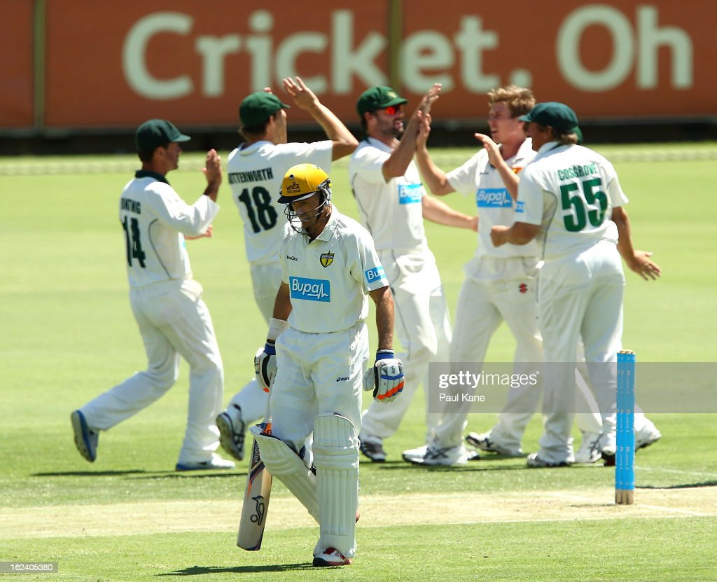 <a gi-track='captionPersonalityLinkClicked' href=/galleries/search?phrase=Michael+Hussey&family=editorial&specificpeople=171690 ng-click='$event.stopPropagation()'>Michael Hussey</a> of the Warriors walks from the field as James Faulkner of the Tigers celebrates with team mates during day three of the Sheffield Shield match between the Western Australia Warriors and the Tasmania Tigers at WACA on February 23, 2013 in Perth, Australia.