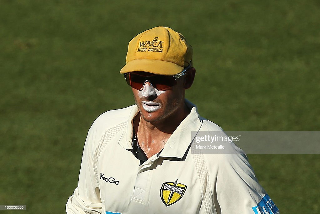 Michael Hussey of the Warriors walks from the field at the end of play during day two of the Sheffield Shield match between the New South Wales Blues and the Western Australia Warriors at Blacktown International Sportspark on January 25, 2013 in Sydney, Australia.