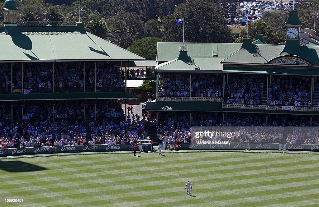 Michael Hussey walks from the ground after being run out during his last test match during day two of the Third Test match between Australia and Sri Lanka at Sydney Cricket Ground on January 4, 2013 in Sydney, Australia.