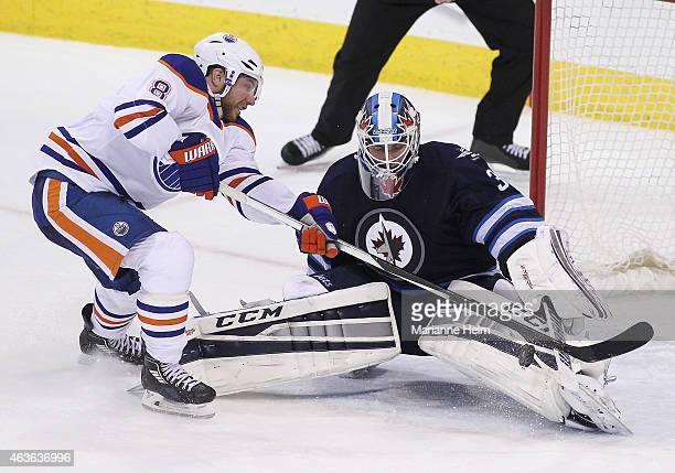 Michael Hutchinson of the Winnipeg Jets blocks a shot on goal by Derek Roy of the Edmonton Oilers in shootout action in an NHL game at the MTS Centre...