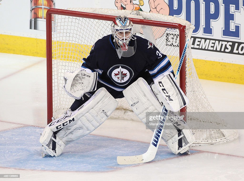 Michael Hutchinson #34 of the Winnipeg Jets protects his net during the third period of the NHL game against the Boston Bruins at the MTS Centre on April 10, 2014 in Winnipeg, Manitoba, Canada.
