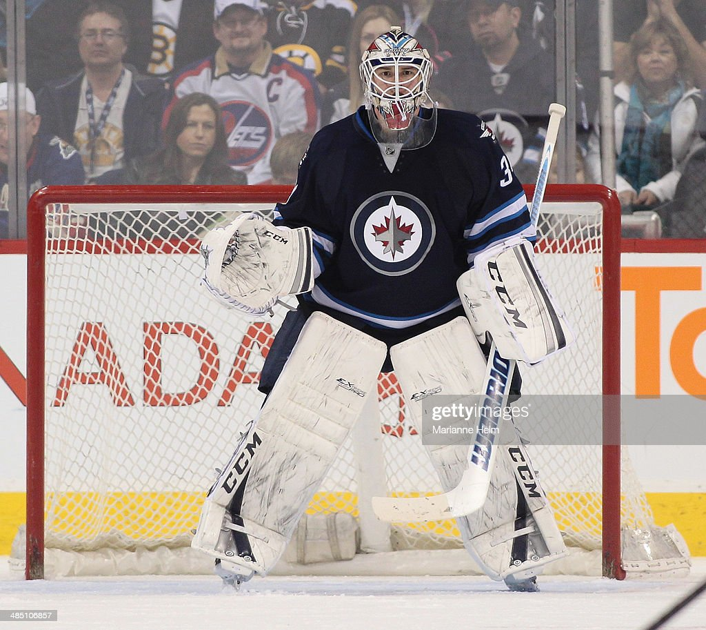 Michael Hutchinson #34 of the Winnipeg Jets protects his net during the second period of the NHL game against the Boston Bruins at the MTS Centre on April 10, 2014 in Winnipeg, Manitoba, Canada.