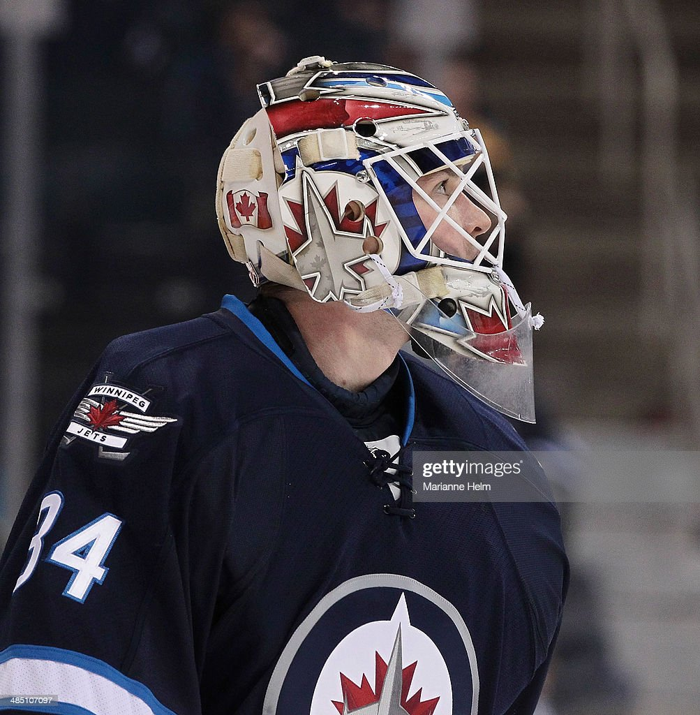 Michael Hutchinson #34 of the Winnipeg Jets warms up before an NHL game against the Boston Bruins at the MTS Centre on April 10, 2014 in Winnipeg, Manitoba, Canada.