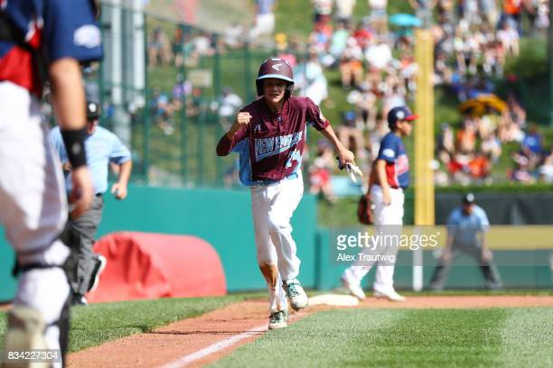 Michael Iannazzo of the New England team from Connecticut pumps his fist on the way to scoring a run during Game 2 of the 2017 Little League World...