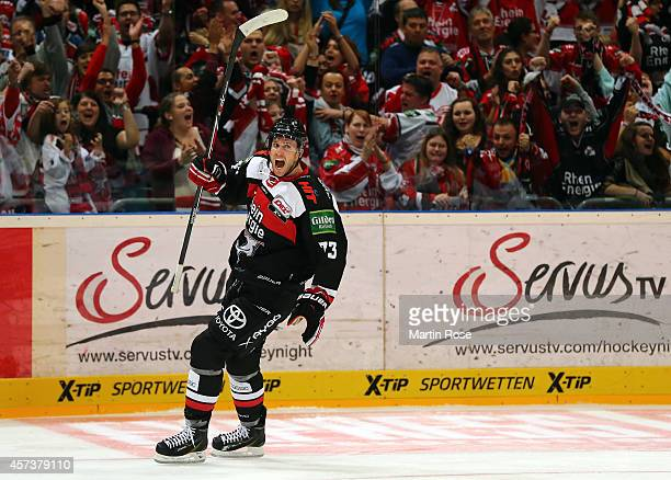 Michael Iggulden of Koelner Haie celebrates after he scores th eopening goal during the DEL Ice Hockey match between Koelner Haie and Eisbaeren...