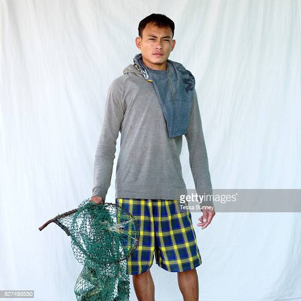 Michael Illustrismo fisherman Pooc Bantayan Island The Philippines Every morning at 7 am fisherwomen meet fishermen as they return from the sea with...