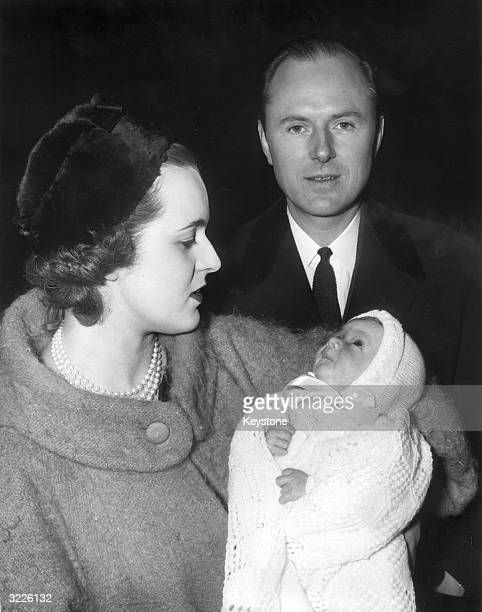 Michael Inchbald with his wife and son Courtenay after the child's christening at St Mary's Church in Cadogan Square London Inchbald a Chelsea...