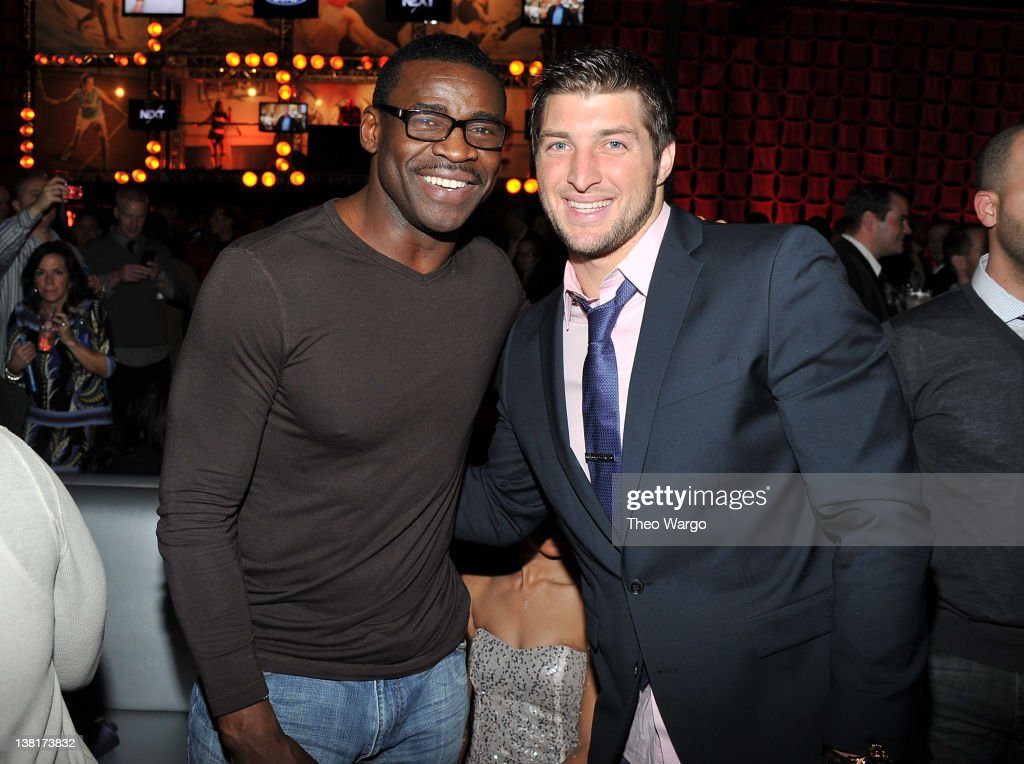 <a gi-track='captionPersonalityLinkClicked' href=/galleries/search?phrase=Michael+Irvin&family=editorial&specificpeople=218074 ng-click='$event.stopPropagation()'>Michael Irvin</a> and <a gi-track='captionPersonalityLinkClicked' href=/galleries/search?phrase=Tim+Tebow&family=editorial&specificpeople=2729658 ng-click='$event.stopPropagation()'>Tim Tebow</a> attend ESPN The Magazine's 'NEXT' Event on February 3, 2012 in Indianapolis, Indiana.