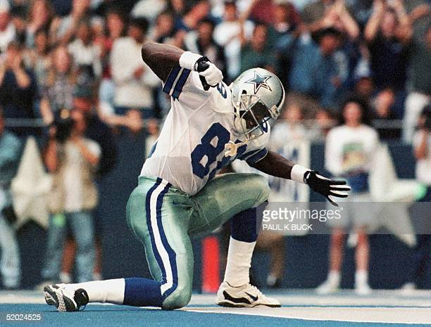 Michael Irvin of the Dallas Cowboys celebrates his pass reception to the one yard line that set up Dallas' first touchdown in their game with the...