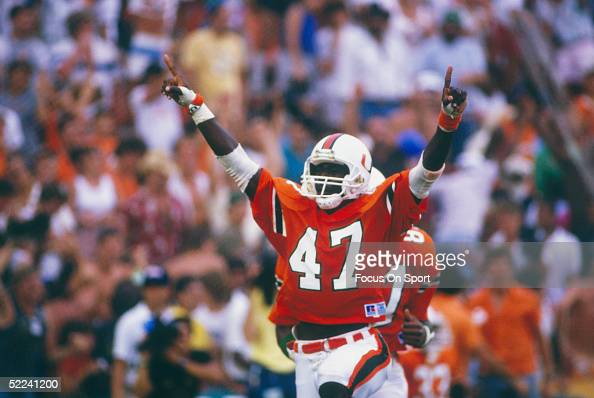 Michael Irvin of the Miami Hurricanes celebrates against the Notre Dame Fighting Irish at the Orange Bowl on November 28 1987 in Miami Florida The...