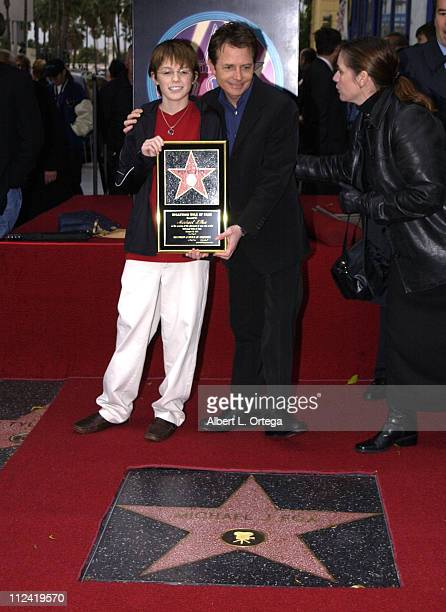 Michael J Fox and son Sam during Michael J Fox Honored with a Star on the Hollywood Walk of Fame for His Achievements in Film at Hollywood Boulevard...