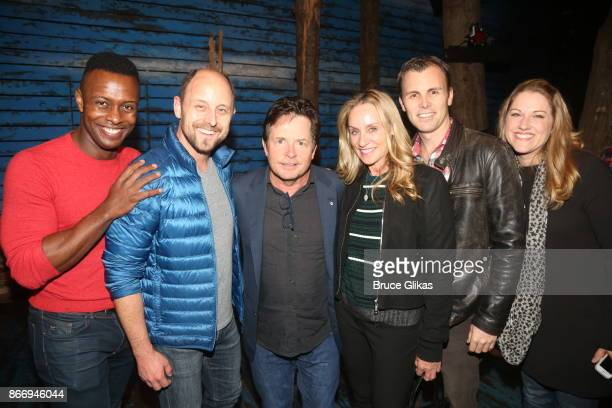 Michael J Fox and Tracy Pollan pose backstage with the cast of the hit musical 'Come From Away' on Broadway at The Gerald Schoenfeld Theatre on...