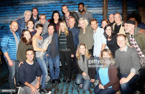 Michael J Fox and Trecy Pollan pose backstage with the cast of the hit musical 'Come From Away' on Broadway at The Gerald Schoenfeld Theatre on...