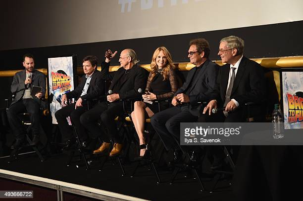 Michael J Fox Christopher Lloyd Lea Thompson Huey Lewis and Bob Gale speak onstage with moderator Aaron Sagers during the Back to the Future reunion...