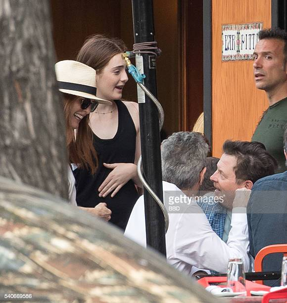 Michael J Fox meets Julianne Moore and her daugther Liv Freundlich while having dinner with his wife Tracy Pollan and few friends at Bar Pitty on...