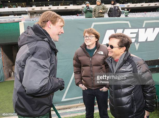 Michael J Fox meets with former New York Jets Quarterback and Honorary Captain Chad Pennington when they attend the Oakland Raiders vs New York Jets...