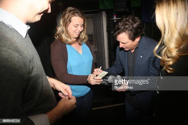Michael J Fox signs his book backstage at the hit musical 'Come From Away' on Broadway at The Gerald Schoenfeld Theatre on October 26 2017 in New...