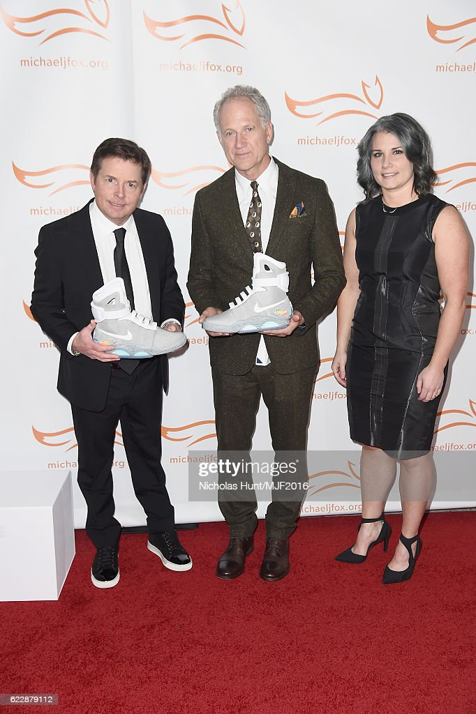 Michael J. Fox, Tinker Hatfield, and Tiffany Beers pose with a Nike Mag during Michael J. Fox Foundation's 'A Funny Thing Happened On The Way To Cure Parkinson's' gala at The Waldorf=Astoria on November 12, 2016 in New York City.