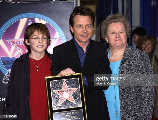 Michael J Fox with son Sam and mom Phyllis during Michael J Fox Honored with a Star on the Hollywood Walk of Fame for His Achievements in Film at...