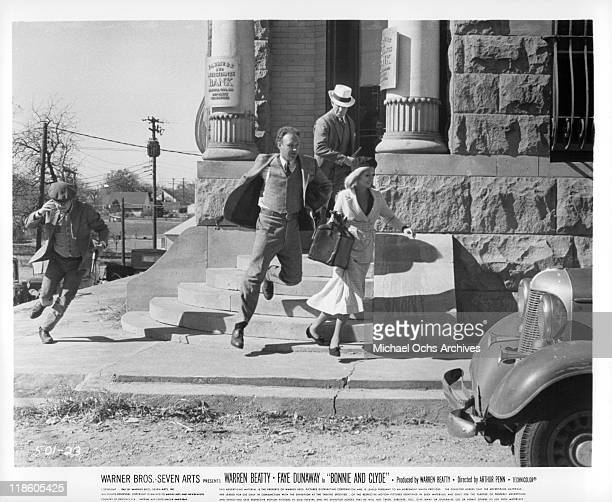 Michael J Pollard Gene Hackman Faye Dunaway and Warren Beatty run out of bank with 'loot' in a scene from the film 'Bonnie and Clyde' 1967